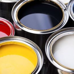Several open canisters of paint